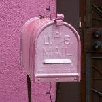 Mailbox matching pink house