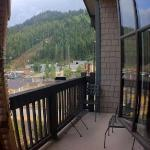 Balcony and view of parking lot and mountain