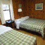 Bayview Cabin back bedroom with 2 Queens