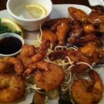 Shrimp and hot wings from happy hour menu