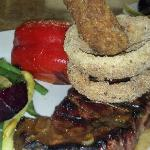 All natural Angus Ribeye w/jalape?o dusted onion rings.