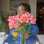 My mom taking in the view and fresh flowers on the table before being served breakfast!