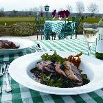 alfresco dining on the terrace overlooking the golf course