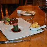 Pecan Crusted Barbecued Short Rib alongside a Miniature Filet Mignon Enrobed in Swiss Chard