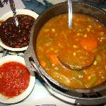 Beef vegetable soup, with a side of beans and salsa