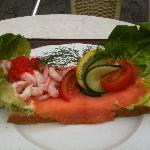 shrimp, smoked salmon, masago, on bread with mayo, hard-boiled eggs. with dill, cucumber, lemon