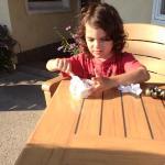 enjoying ice cream in outdoor seating.