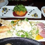 Delicious appetizers: panko-crusted brie with crostini and smoked duck with greens