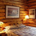 Maluhia Log Cabin Queen Bedroom. 2 BR cabin has shared bath with oversize tile shower.