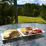Enjoying a platter of yummy food one the deck in the sun.
