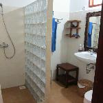 Basic bathroom in garden bungalow, with hot water
