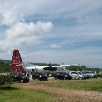Private airstrip, being met by a fleet of SUVs