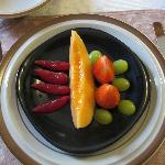 Fresh fruit with puree, often served with homemade oatmeal or muffins