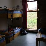 The 6 bed dorm with 3 beds upstairs