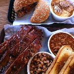 Beef brisket sandwich & banana pudding at the top, ribs with sides of black-eyed peas & BBQ bean