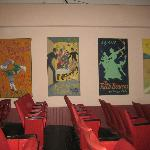 Inside the theatre and the colorful posters advertising the upcoming plays