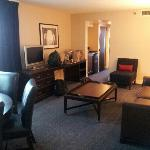 living area in conference suite (with all of our junk by the tv)