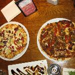 Artichoke (left) and sausage pizzas.