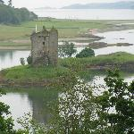 View of Castle Stalker from pathway beside cafe