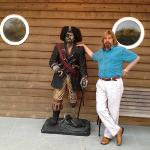 two pirates standing outside of Quartermaster's!