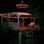 gazebo with the pond next to it (at night)
