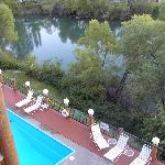 View of pool & Whitefish river from room balcony