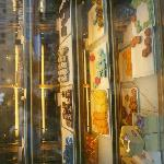 Window with displayed cakes and pastry