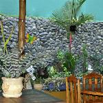 Part of dining area and beautiful plants