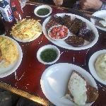 (L to R) Milanesa, mashed potatos, fries, meat