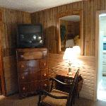 TV and rocking chair in main bedroom - cabin 6