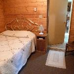 Small room you enter cabin in features double bed - cabin 6