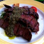 A close-up of my Flat Iron Steak with crushed olives, cherry tomatoes, onions, and croutons- DEL
