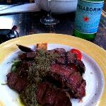 Bacchanal Restaurant -- Flat Iron Steak with crushed olives, cherry tomatoes, onions, croutons-