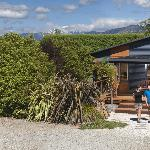 The Backpacker Lodge is at the rear, next to a kiwi orchard.
