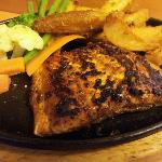 Hot plate grilled salmon with choices of sauce honey BBQ, Black Pepper, Teriyaki and Mushroom.