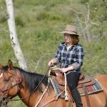 Daughter learns to be a cowgirl