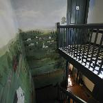 Stairs up to room with lovely mural