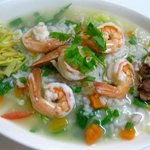 Rice soup with fresh vegetables, shrimp, ginger and roasted garlic.