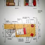 Picture on the wall of plan/layout of new room design