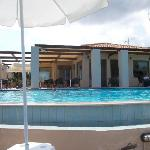 Pool and hotel showing eating area