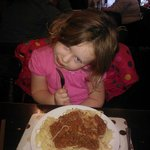 Amelie munching on her child size portion of spag bol :-)
