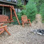 Sitting area with fire pit right by the lodge