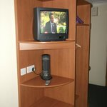 Television and Fan in room.