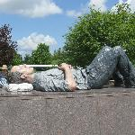 Sculpture of resting man