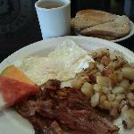 Piping hot coffee, crispy bacon, medium well eggs, delish home fries and lightly toasted rye...