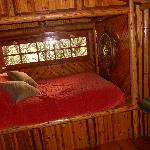 bed in one of the rooms