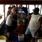 Dive boat, with divers and Dive Master