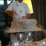 The chef using liquid nitrogen by the table to make sorbet