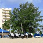 rental tent and wave runners and more cabanas with lounge chairs
