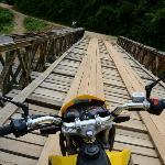 Taking one of the many bridges around Vang Vieng